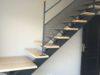 escalier-compos-dun-seul-limon-et-quart-tournant